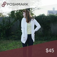 """J.Crew White Button Down Long Cardigan Long and cozy white button down cardigan from J.Crew  // 100% cotton // // Oversized // // Great preloved condition // // 2 pockets // // V- neck with 5 buttons //  Size large, measurements: Armpit to armpit 20"""" Sleeve length 34"""" Length 29""""  #jcrew #buttondown #cardigan #basics #oversized #white #sizelarge #shopdistracted J. Crew Sweaters Cardigans"""
