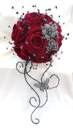 Stunning brooch and artificial flower bridal bouquet. $309.59, via Etsy.