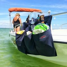 Free Priority Shipping on all Products -   3 Pocket Boat Organizer Bag.  Great for storing all your water time gear.  Made of Premium rugged outdoor Performance Polyester Fiber, mold and mildew resistant Fabric.  Water resistant Urethane coating. Resistant to UV damage.  Multiple colors available to match your boat color scheme.  Orange is premium pricing.