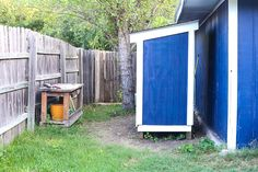 This small wooden shed is big enough to store a lawn mower and some gardening supplies. We'll show you how to build one just like it in your backyard. Backyard Buildings, Backyard Sheds, Outdoor Sheds, Shed Design Plans, Diy Shed Plans, Building A Storage Shed, Storage Shed Plans, Diy Shed Kits, Garden Tool Shed