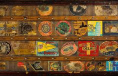 Collection of Vintage travel stickers on the side of an Antique Suit Case