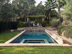 Love the look and feel of this pool.  Bigger stone area for chairs around pool.  No hot tub.  But like grass on exterior