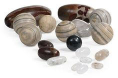 A GROUP OF INDIAN MARBLE SPHERES, LINGHAM STONES AND ROCK CRYSTAL SPECIMENS