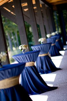 Blue and gold table covers add color to the room and draw together the wedding colors.