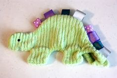 bubbles+bobbins: Tutorial: How to make a Dinosaur (Stegosaurus) Taggie Doll    I made this without the stuffing and added a plastic bag inside to make it crinkle. So cute and easy!