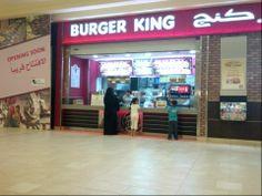 Veiled woman buying snacks for her children at Dar Asalam Mall - Doha, Qatar