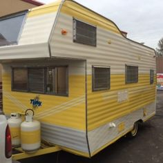 This 16-ft. vintage trailer has been completely restored inside and out, with an all new birch interior and refurbished appliances. It sports new flooring, counters, upholstery, and a two-toned yellow and cream exterior paint job.