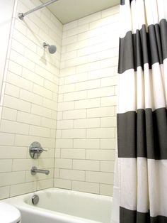 Shower curtain/rod - West Elm/Target; Shower tile/grout (subway) - Daltile 4x12 (Biscuit)/Mapei #01 (Alabaster); Shower trim/ tub spout - Grohe Concetto; Toilet - Toto; Tub - American Standard; Wall paint/trim - Benjamin Moore (China White)