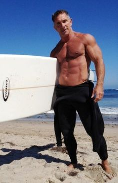 fit surfer over age 50 http://lifequalityexaminer.com/improve-health-fitness-after-age-50/