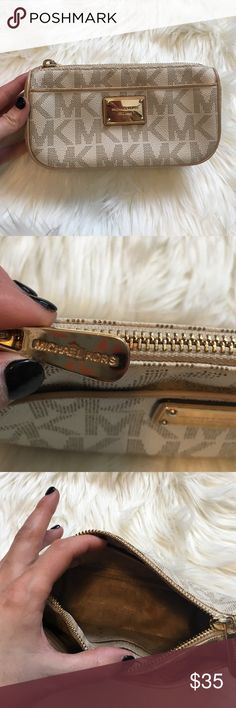 Amazing White Michael Kors Monogram Pouch Amazing white Michael Kors pouch. No flaws on the outside at all and the inside has little wear, just two small stains. It has TONS of life left. 7 inches long 4 inches high. NO TRADES PLEASE Michael Kors Bags Cosmetic Bags & Cases