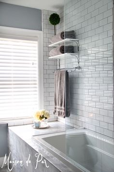 Beautiful before and after inspiration for the ultimate bathroom remodel complete with subway tiles and modern lines.