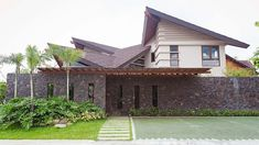 Contemporary Filipino furniture, natural materials, and a design that lets the sun and air in complete this tropical home Filipino Architecture, Philippine Architecture, Bamboo Architecture, Tropical Architecture, House Architecture, Modern Tropical House, Tropical Design, Tropical Houses, Tropical Interior