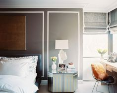 Gray walls with white trompe-l'oeil picture molding. Interior Design: Laura Garcia