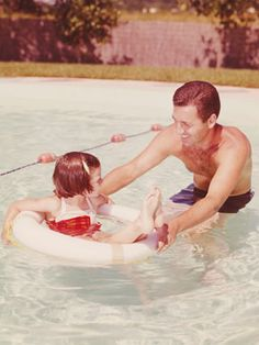 vintage photo - dad & daughter pool time.