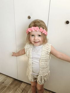 A toddler crochet vest pattern that has a boho feel. The free crochet pattern is simple for beginners and uses only 1 skein of cotton yarn.