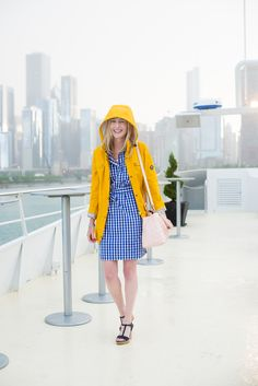 Bright yellow rain jacket and blue and white gingham dress!