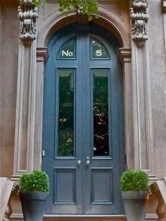 boxwoods + blue front door