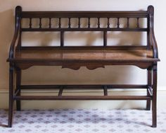 A Victorian walnut bench, circa 1880, in the manner of Shoolbred and Co.  the galleried back and solid seat on moulded sabre legs  81cm. high, 106cm. wide, 34cm. deep; 2ft. 8in., 3ft. 5½in., 1ft. ½in.