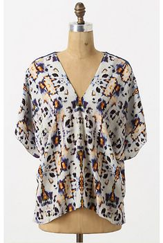 nice lines for a simple, basic summer top.  draft in four rectangular pieces, or six.  eight w/saddle yoke