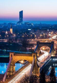 Two landmarks of Wroclaw (Poland) - Grunwaldzki Bridge, old suspension bridge built in 1910, and Sky Tower,the highest building in Poland (212m/695ft).
