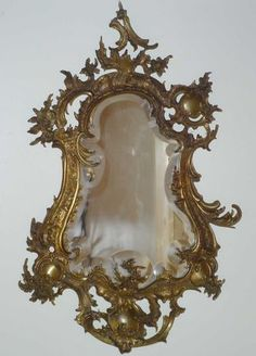 Rococo Mirror. Carved Gilt Wood Gesso and Mirrored Glass. France. Circa Late 18th-Century.