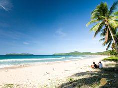 Long and wide white sand Nacpan Beach