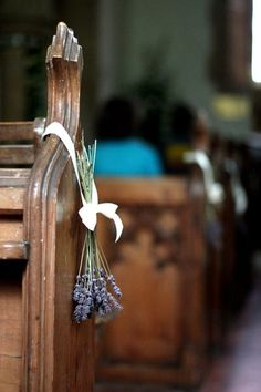 If you've forgotten about aisle decor, head over to the flower shop and purchase some lavender and ribbons, and voila -- a simple, yet elegant accent for your ceremony venue.  Image via  The Natural Wedding Company .