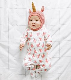 The total unicorn look, in our organic layette and baby alpaca hat
