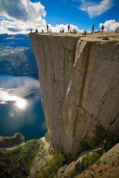 Preikestolen, Norway. 1,982 ft. drop to the ocean. THIS is gorgeous. It is also an example of the stark contrast between America and most other countries. in America there would be 20 foot fences around the edge of that cliff haha.