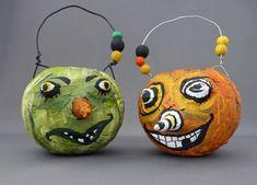 Halloween Körbchen als witzige Kürbis-Köpfe basteln