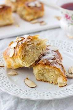 Flaky puff pastry is stuffed with a mixture of sweet almond paste and orange zest, rolled into a log and baked until crispy perfection.