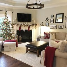 45 Easy DIY Dollar Store Christmas Decorations for Decorating on a Budget - The Trending House Christmas Living Rooms, Christmas Home, White Christmas, Sala Grande, Round Chandelier, Farmhouse Christmas Decor, Tv Stand Christmas Decor, Living Room With Fireplace, Red Living Room Decor