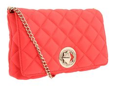 Kate Spade Gold Coast Meadow bag.  Love the nod to the classic Chanel quilted bag.  They offer some classic & whimsical colors at a fraction of the cost.  Her bags are well made and so very functional:)  Love me some Kate:P