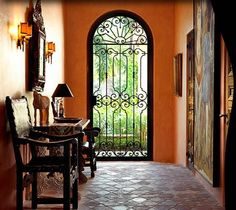 Foyer with black iron gate Spanish style House like this on coffeepot blvd I love! Spanish Style Decor, Spanish Style Homes, Spanish House, Spanish Revival, Spanish Colonial, Spanish Tile, Style Hacienda, Mexican Hacienda, Mexican Style