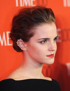 The full-bodied up-do, beautifully demoed by Emma Watson. They key here is getting plenty of texture into your hair before crafting the messy bun. Tong your hair all over first, and use some dry shampoo for a matte texture.