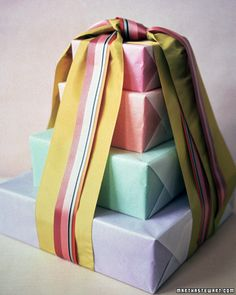 Presents wrapped in colored tissue paper and then glassine. (Could probably also use wax paper and get same results).