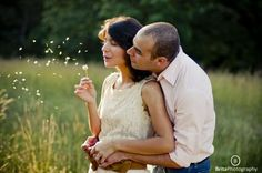 engagement picture pose ideas - Oh gosh, can we please have dandelions in our pictures????