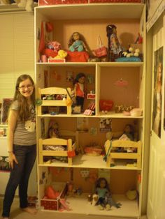 could use an inexpensive book shelf and turn it into this.  The only thing this, and a lot of these homemade American Girl doll houses are missing are Stairs!  My girls love when stairs or elevators connect the floors.. makes it more realistic!! Would cut out area and construct stairs for it!!