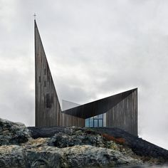 The new Community Church Knarvik signals its function with a sacral dignity and recognisable form, where the church spire, sanctuary and chapel are emphasised by ascending roof planes.