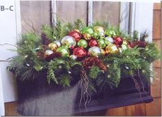 Christmas windowbox! a set or series of these on the stone wall in front of the house?