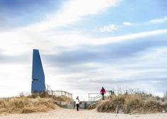Angular seaside tower contains a tilting viewing platform