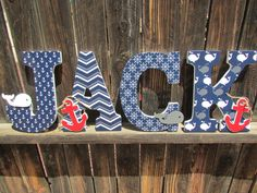 Wall Art Letters - Name - Custom Letter Art - Nursery Art - Embellished - Hand Painted Anchor Whale - Nautical Navy Grey and Red Nursery Art by BubblesOfJoyShop on Etsy https://www.etsy.com/listing/242093443/wall-art-letters-name-custom-letter-art