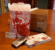 Every year, Universal Orlando sends creative invitations to the press to inform them of a Halloween Horror Nights media event. This year, we received a package from the Universal Palace Theater, the setting for Halloween Horror Nights 19. Inside were a few bloody items, including a popcorn box complete with old popcorn, as well as …