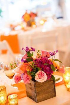 I love this colorful centerpiece in a cool rustic wooden box!  Beautiful!