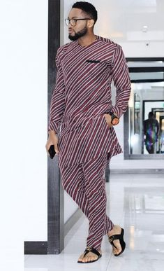 Call, SMS or WhatsApp if you want this style, needs a skilled tailor to hire or you want to expand more on your fashion business. African Wear Styles For Men, African Dresses Men, African Attire For Men, African Clothing For Men, African Shirts, African Women, Nigerian Men Fashion, Indian Men Fashion, Mens Fashion Wear