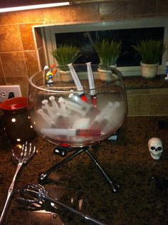 Syringe Jell-O shots with a dry ice for a cool effect and keeps the shots cold. #QuynhTessential #Halloween