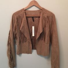 Camel suede fringed jacket NWT Boho Camel super soft suede  fringed Jacket True to size , 100% Polyester,  light weight .  Unlined , Pair with white Tee , jeans/Shorts/ dresses and booties  .  Style is endless .  So Boho on any casual outfit.   No Lowball offer please . Jackets & Coats Blazers