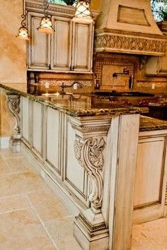 OLD WORLD,TUSCAN,FRENCH,COUNTRY FRENCH AND MEDITERRANIAN STYLE KITCHEN,WITH GORGEOUS PENDANT LIGHTS THAT HANG OVER THE COUNTER TOP FOR EATING OR VISITING THE COOK.....CHERIE