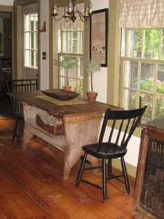 I love this look.  Definitely colonial/prim but not cluttered and dirty looking.