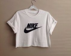 Diy Nike Shirt!! -transfer paper -iron -shirt (cut it to a crop top) -a nike sign - Iron the Nike sign printed on transfer paper on the shirt, roll up the sleeves and done!!
